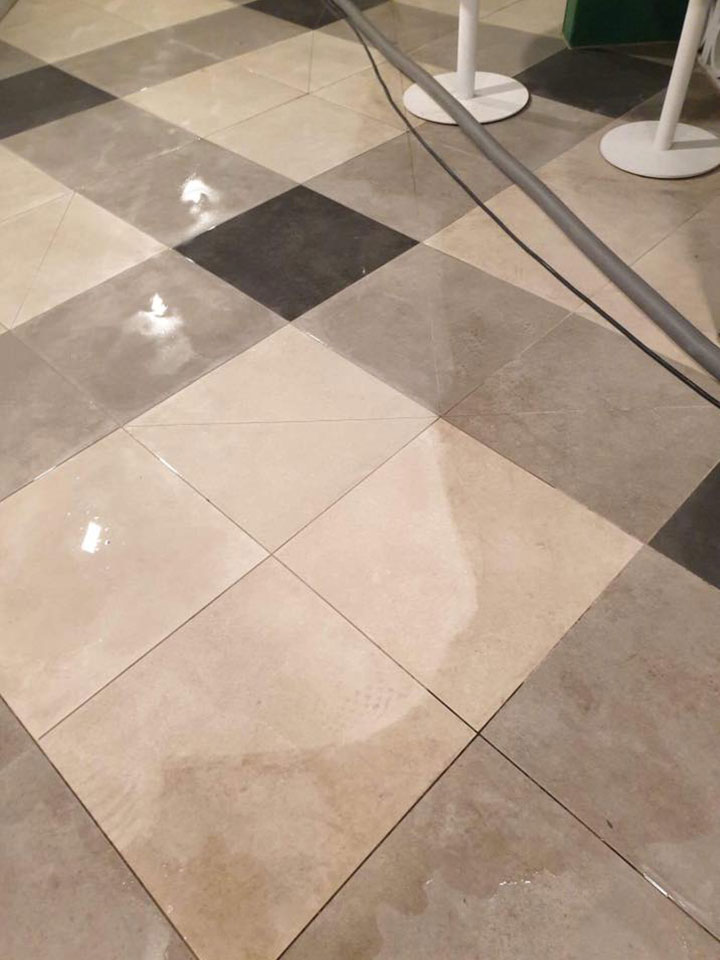 Showing The Difference Between Dirty & Clean Tiles - Huge Difference